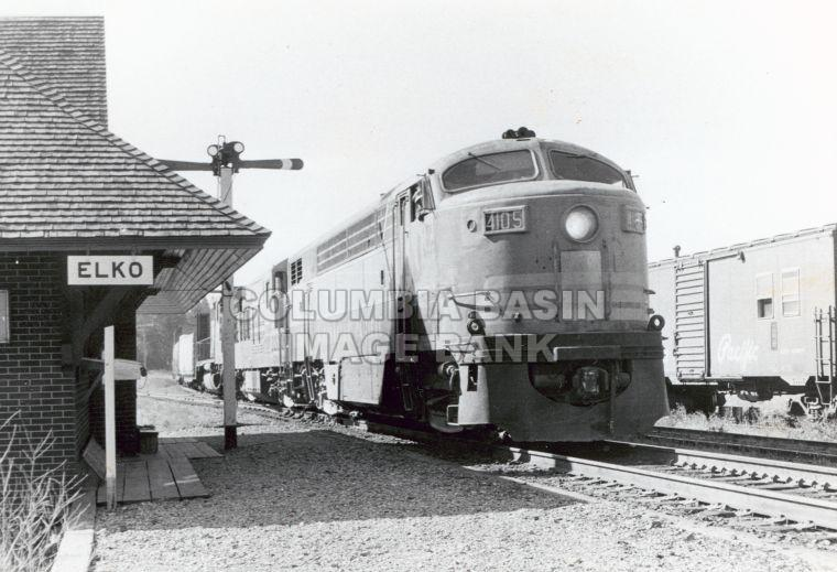 C.P.R. Locomotive #4105 (#980) at Elko, B.C. station with Engineer, Mr. Quail; summer 1973, photo by Grant B. Will