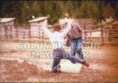 B.C. High School Rodeo: Tammy Hampton competing in sheep roping in Barriere B.C. c.1984